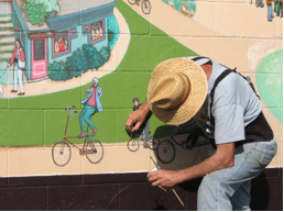 Joe Cotter at work on the Buckman mural
